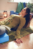 Attractive mixed race woman doing restorative yoga Royalty Free Stock Image