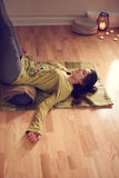 Attractive mixed race woman doing restorative yoga Stock Images