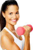 Attractive mixed race woman holding weights, Stock Photo