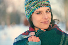 Attractive mixed race woman smilling in the snow Royalty Free Stock Image