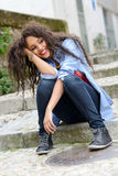 Attractive mixed woman in urban background wearing casual clothe Stock Images