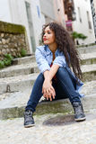Attractive mixed woman in urban background wearing casual clothe Stock Photos