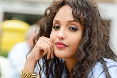 Attractive mixed woman in urban background wearing casual clothe Royalty Free Stock Photo