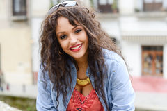 Attractive mixed woman in urban background wearing casual clothe Royalty Free Stock Image