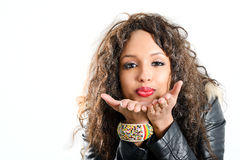 Attractive mixed woman on white background blowing a kiss Stock Images