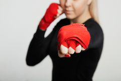 Attractive MMA sportswoman in hand wrap posing . on white background royalty free stock photography