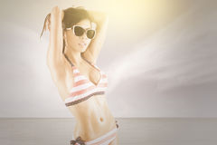 Attractive model with bikini posing at coast Royalty Free Stock Photo