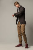 Attractive model in brown jacket and sneakers. stock photography