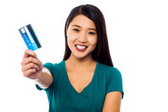 Attractive model displaying her credit card Stock Photo