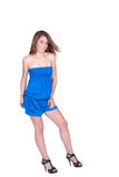 Attractive model in fashion concept. Model in blue short overall isolated on white isolated background in full length, studio shooting. Attractive lady in stock images