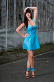 Woman in blue latex dress. A beautiful woman in blue latex dress and high heels Royalty Free Stock Photo