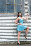 Attractive model. Attractive female in a blue latex dress and wearing high heels Royalty Free Stock Photos