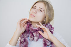 Attractive model  in lapin mauve scarf Royalty Free Stock Image
