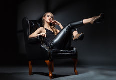 Attractive model with make-up posing on chair Royalty Free Stock Photo