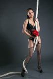 Attractive model posing with rope and bouquet Stock Image