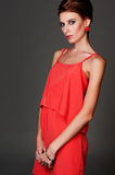 Attractive model in red dress Royalty Free Stock Image