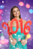 Attractive model with red sign of New Year royalty free stock photography