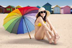 Attractive model sitting at shore Stock Photo