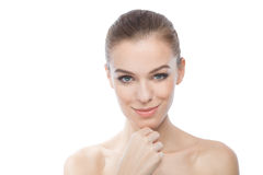 Attractive model smiling while touching her skin, over white bac Royalty Free Stock Image