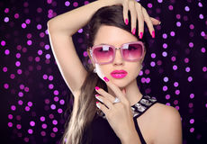 Attractive Model with sunglasses. Beauty girl portrait with pink Royalty Free Stock Image