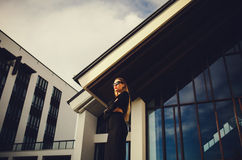 Attractive model in sunglasses standing near the business center Stock Images