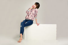 Attractive model wearing pink jacket and jeans. stock photos