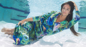 Attractive model wearing a print dress underwater. Stock Images