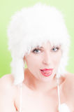Attractive model wearing white fur hat acting funny Royalty Free Stock Photography