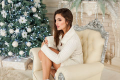 Attractive model on white armchair Royalty Free Stock Photography