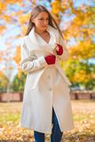 Attractive Model in White Autumn Coat and Gloves Stock Image