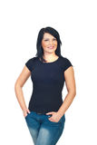 Attractive model woman in black t-shirt. Attractive model woman in blank black cotton t-shirt standing with hands in jeans pockets isolated on white background Royalty Free Stock Photography