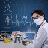 Attractive modern doctor working on laptop Stock Image