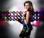 Attractive modern girl in night club. Recreation (nightlife)- attractive girl in night club in contemporary colorful dress Royalty Free Stock Photos