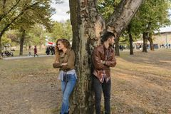 Young couple ignoring each other in the public park royalty free stock photo