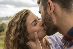 Close-up view of young couple kissing royalty free stock photography