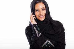 Muslim woman phone. Attractive modern muslim woman talking on cell phone Stock Images