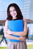 Attractive modern student at schoolyard Royalty Free Stock Photo