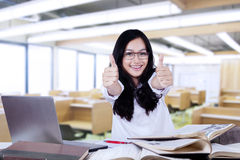 Attractive modern student with thumbs up Stock Photography