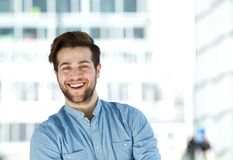 Attractive modern young man with beard smiling Stock Photo