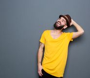 Attractive modern young man laughing Stock Photography