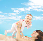 Attractive mom holding her tiny daughter Royalty Free Stock Photo