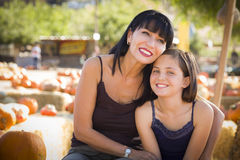 Attractive Mother and Daughter Portrait at the Pumpkin Patch. Attractive Mother and Baby Daughter Portrait in a Rustic Ranch Setting at the Pumpkin Patch Royalty Free Stock Photos