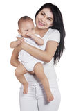 Attractive mother and her baby in studio Royalty Free Stock Photo
