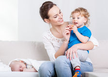 Attractive mother and her sons Stock Image