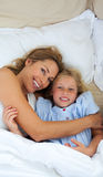 Attractive mother hugging her daughter Stock Images