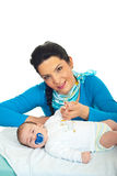 Attractive mother with newborn baby Royalty Free Stock Images