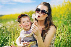 Attractive mother playing with her lovely son Stock Photo