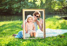 Attractive mother posing with her cute daughter Royalty Free Stock Photography