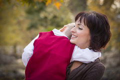 Attractive Mother and Son Hugging Outside Royalty Free Stock Photo