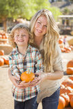Attractive Mother and Son Portrait at the Pumpkin Patch Stock Photo